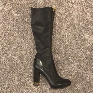 Black leather knee high boots with gold accents